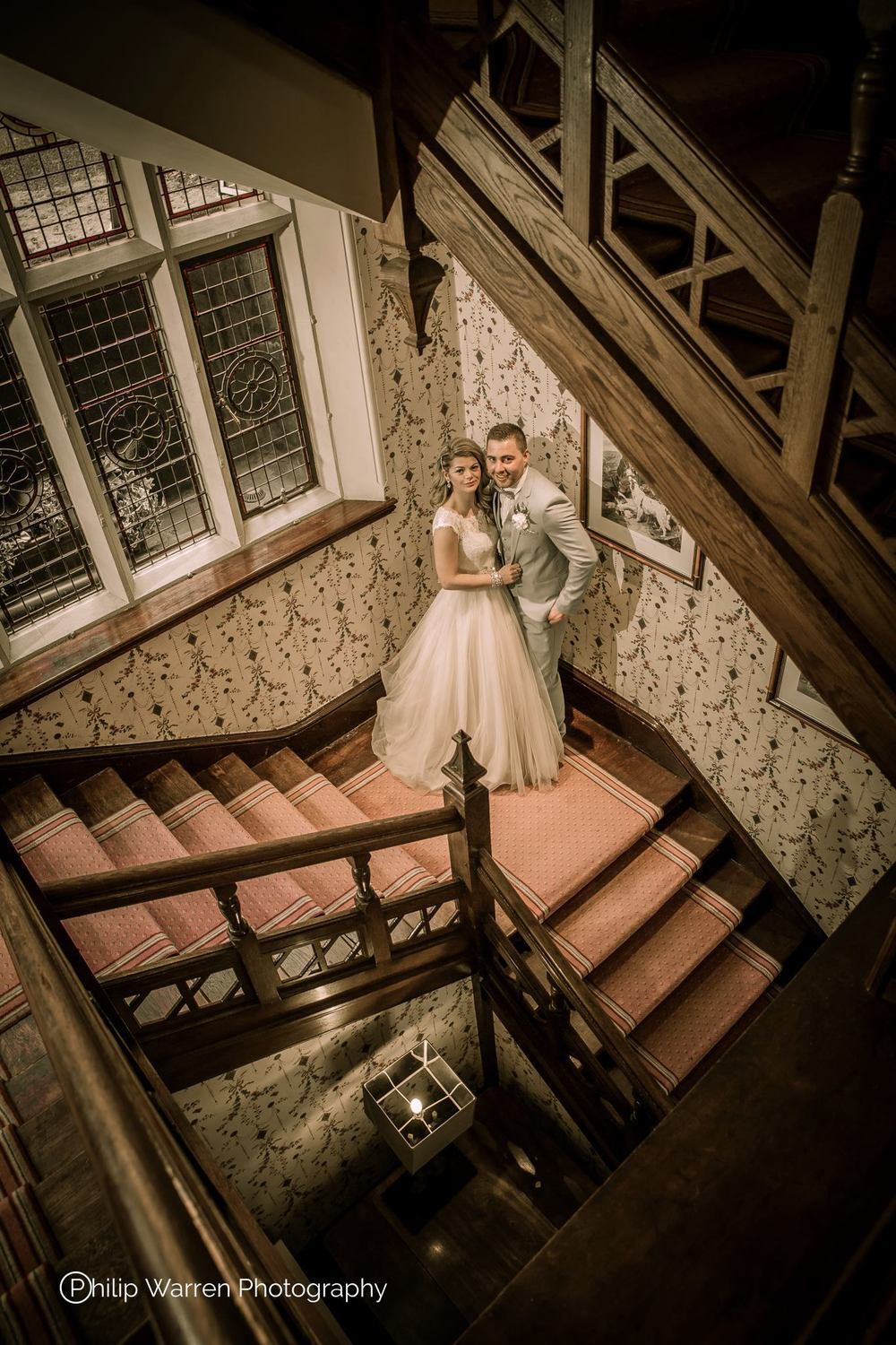Bride and Groom on Stairs at Coed-y-Mwstwr