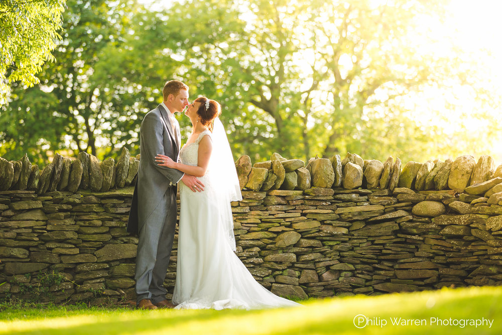 bride and groom in summer light