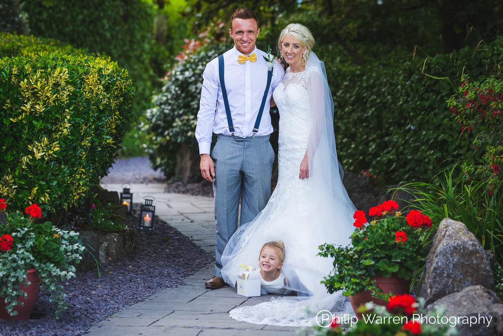 Flower Girl Hding Under Wedding Dress