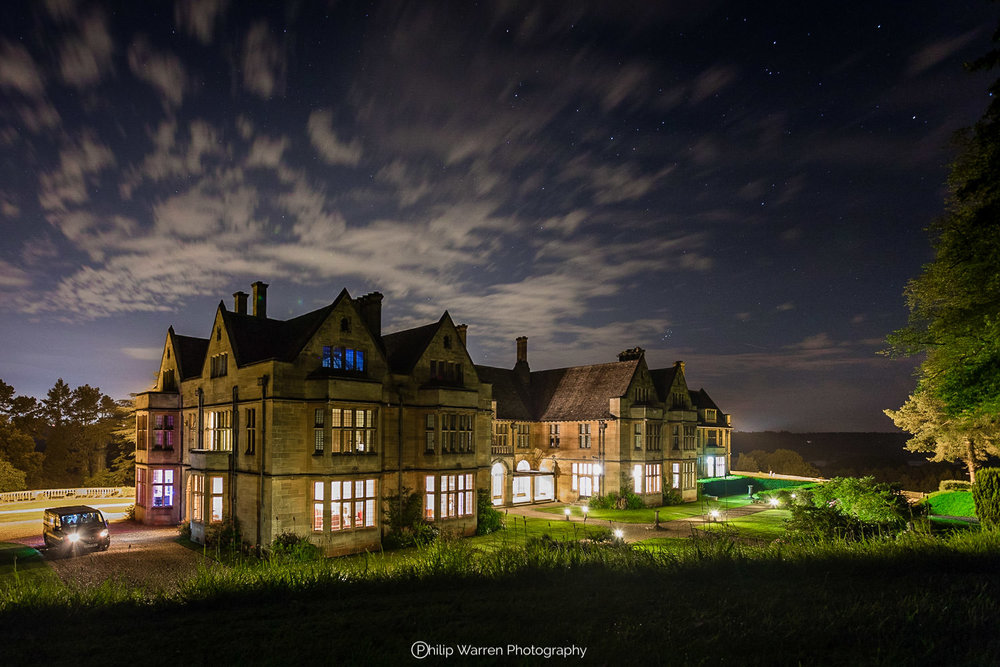 night photo of coombe lodge at blagdon