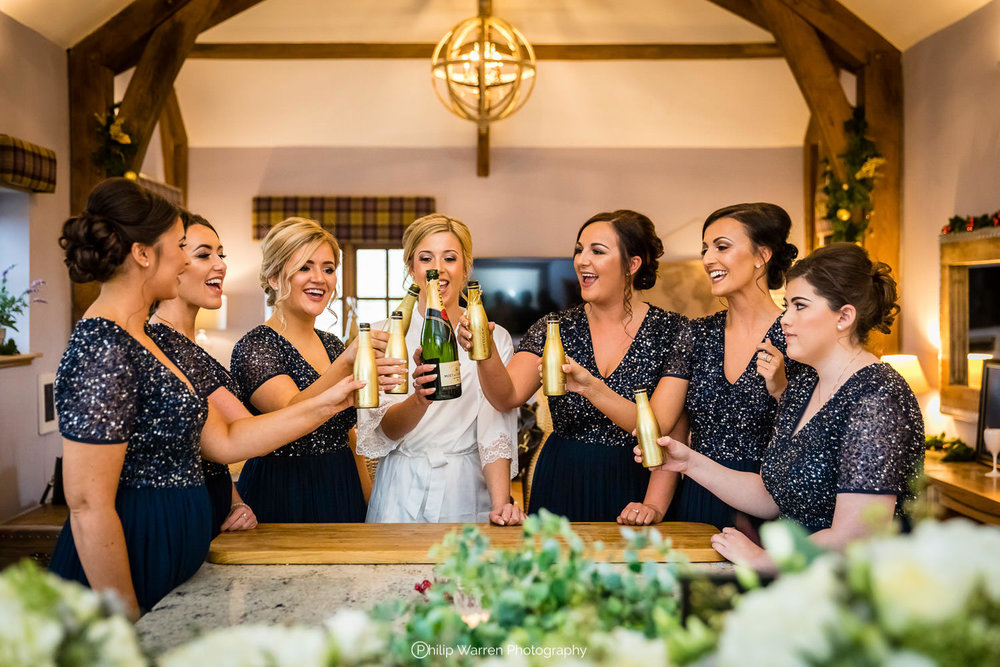 bridal party toasting before wedding