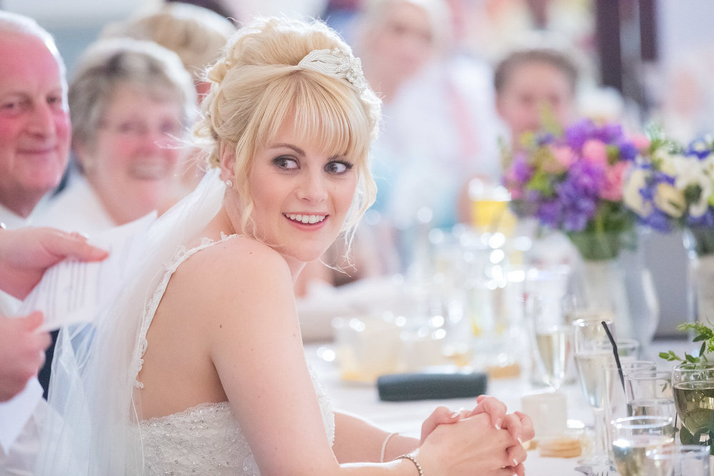 gorgeous bride durung speeches at wedding