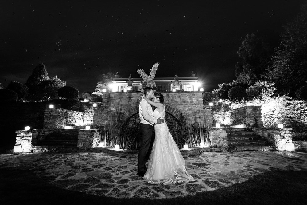 night wedding photo of bride and groom at glenfall house