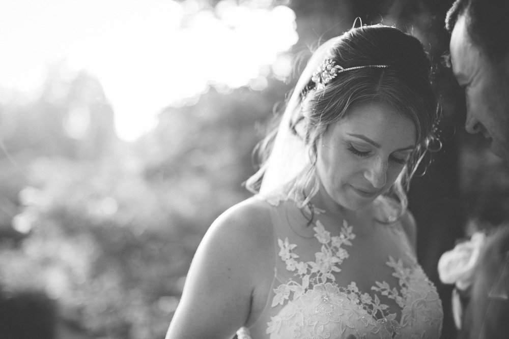 black and white photo of bride close to groom