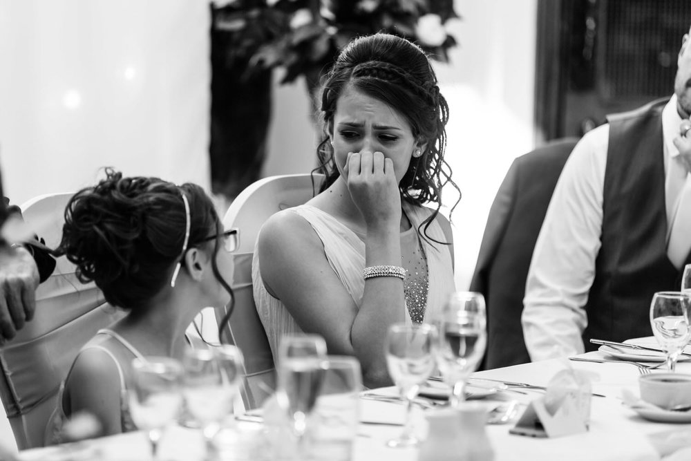 crying bridesmaid at wedding speeches
