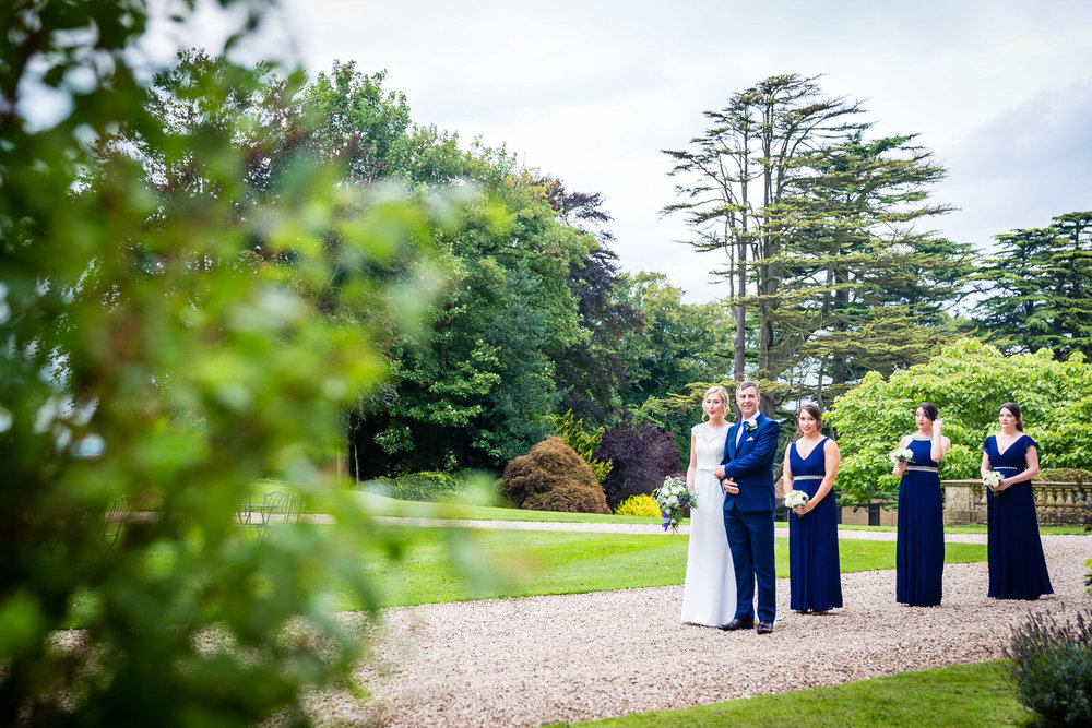 bridal party waiting at outdoor ceremony at coombe lodge blagdon