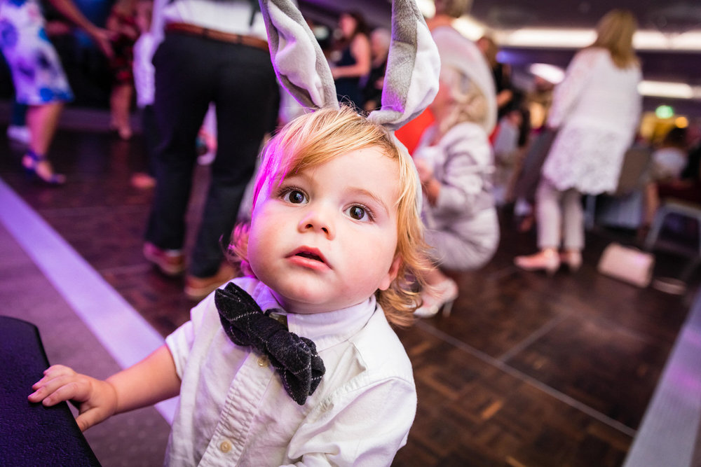 page boy with bunny ears on the dancefloor