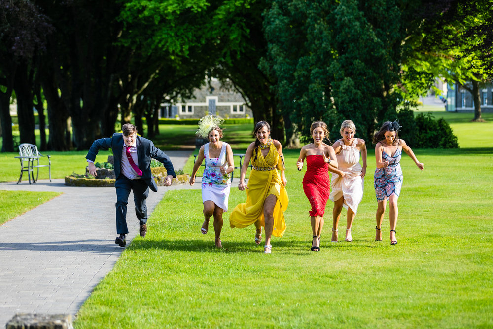 guests running at wedding at hensol castle
