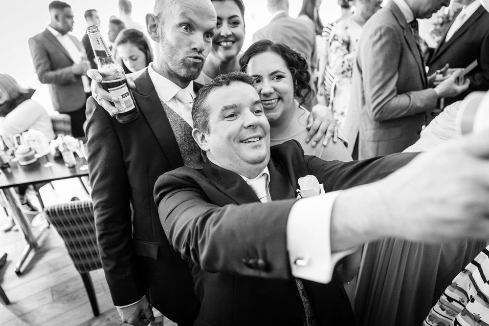 wedding guests taking selfies