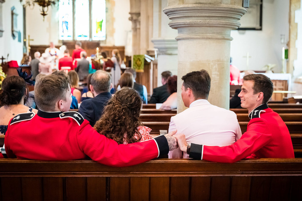 welsh guards holding hands in church