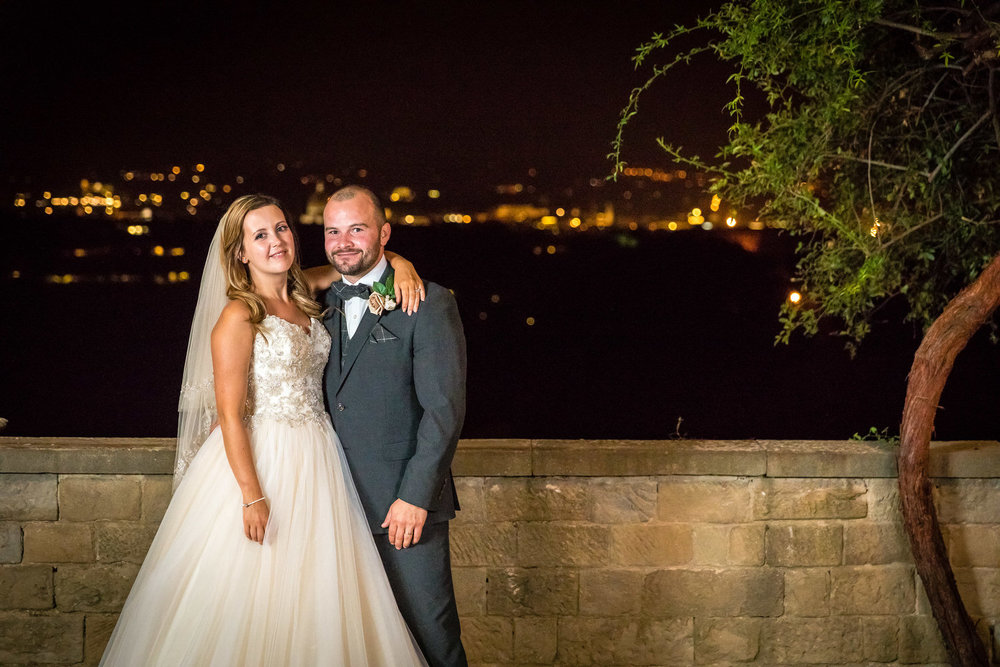 photos of bride and groom at night with florence in the backgrou