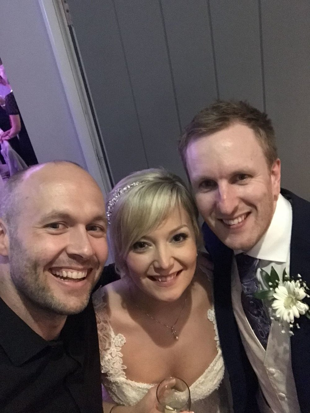 selfie of me and bride and groom