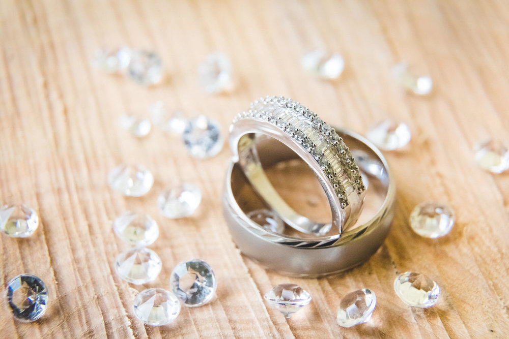 wedding rings on wood with crystals