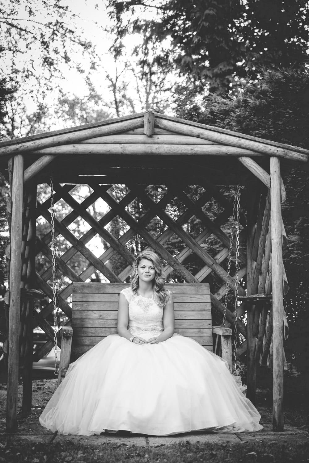 bride sat on the swing at coed y mwstwr