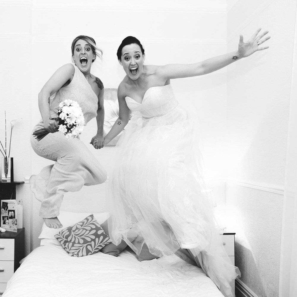 jumping on bed to celebrate the wedding