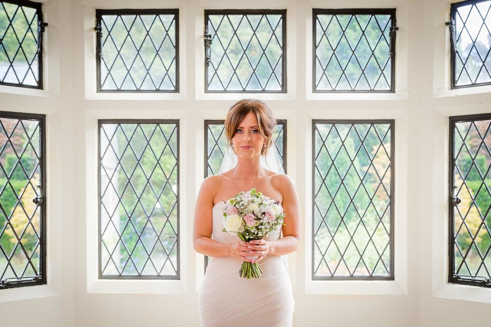 bride holding bouquet at miskin manor hotel wedding