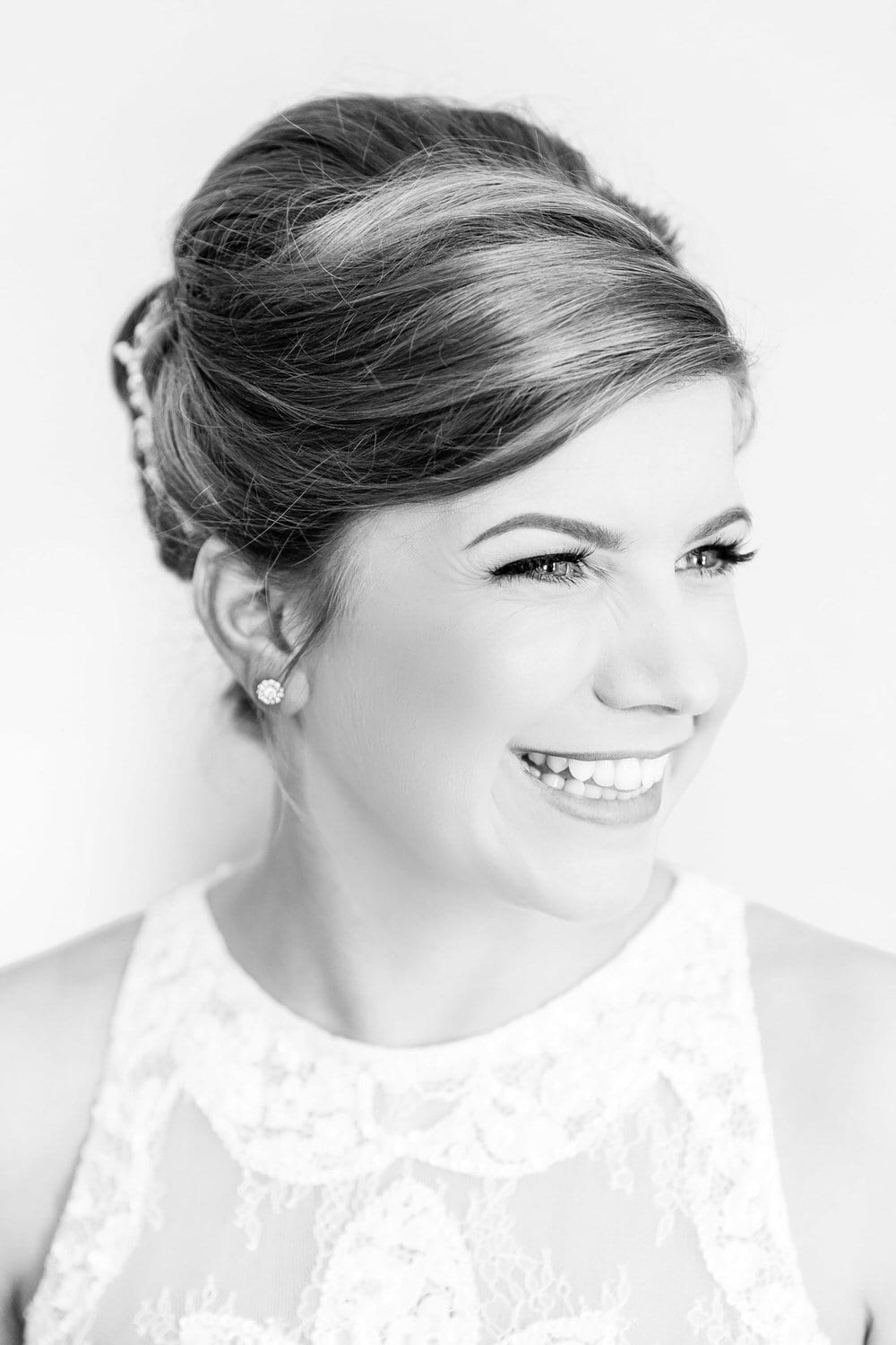 black and white portrait of bride laughing