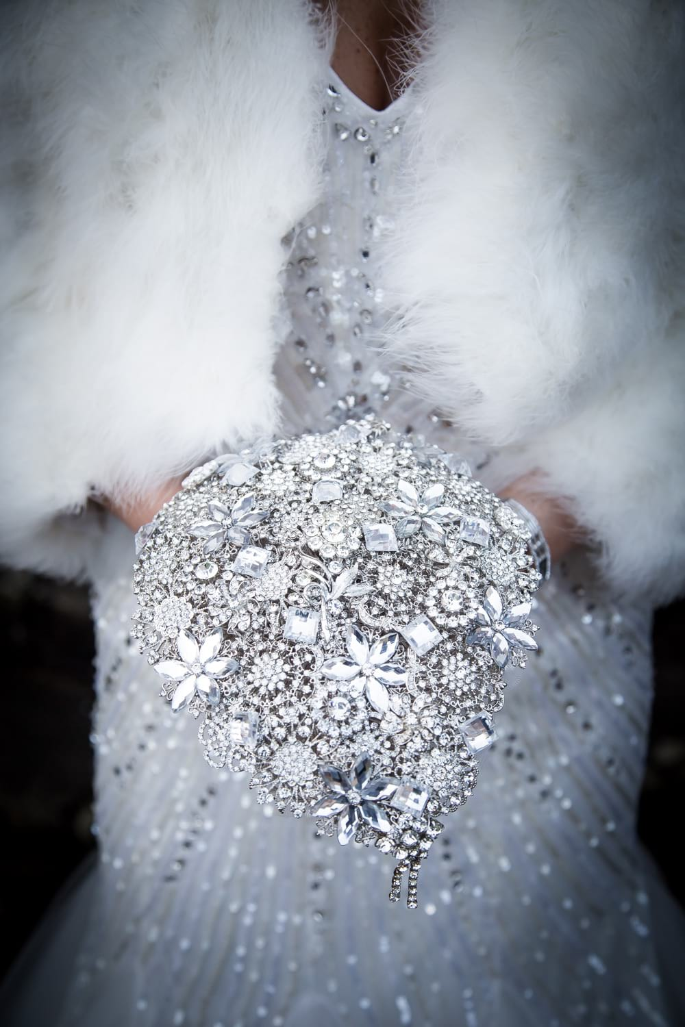 bride holding brooch bouquet