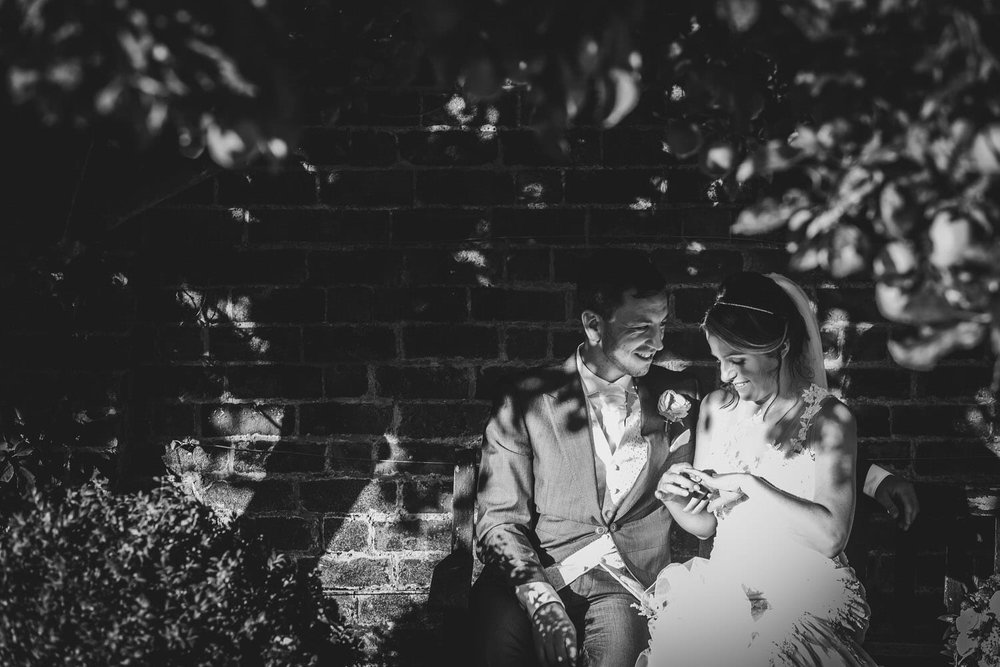 bride and groom on the bench at glenfall house wedding