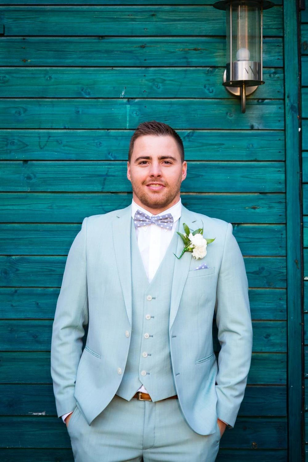 photo of the groom in teal suit
