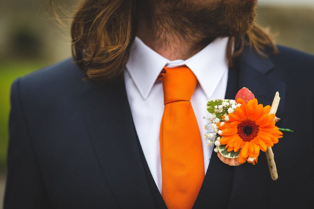 grooms wedding suit and flower