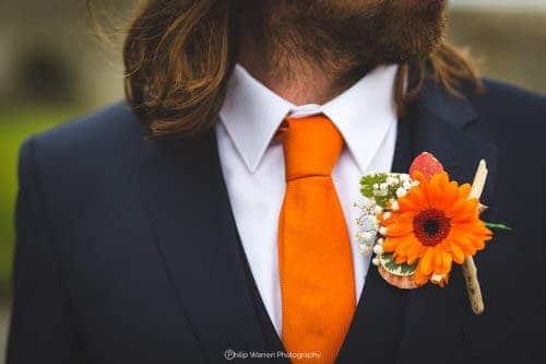 groom in wedding suit by slaters