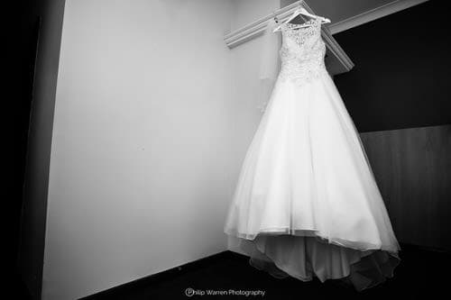 wedding dress hanging in the vale