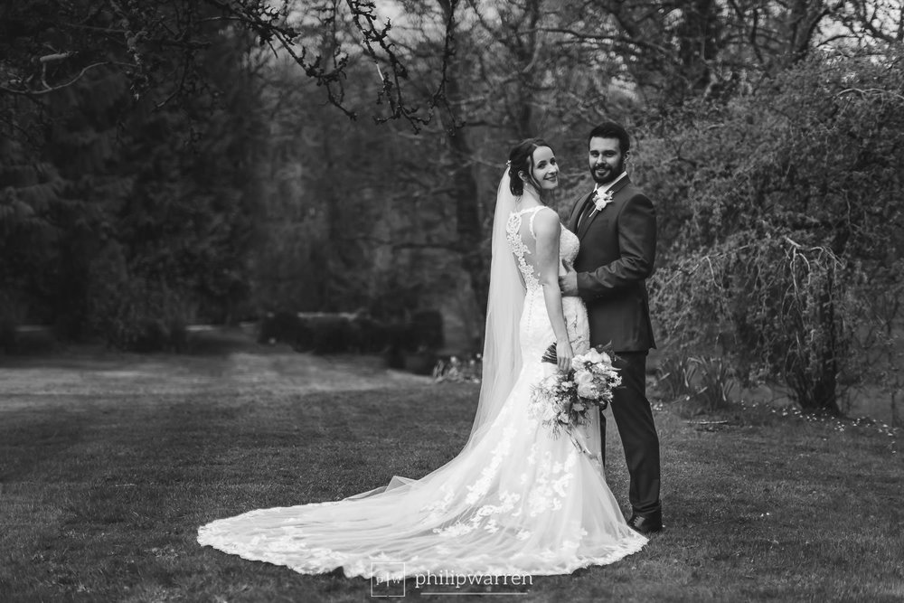 bride and groom in the grounds of pencoed house