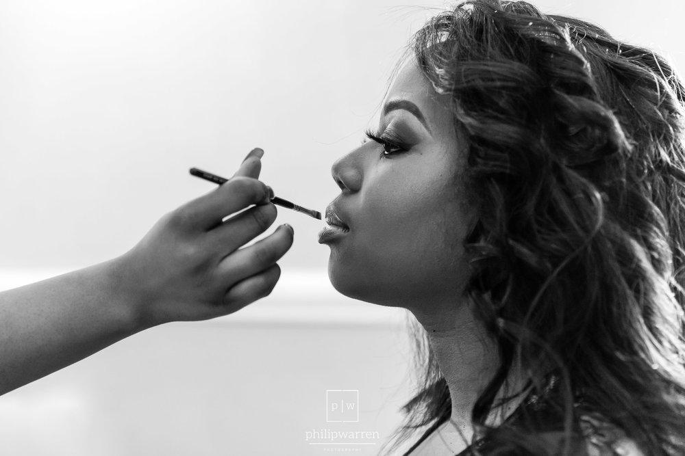 bride having makeup applied in bryngarw house