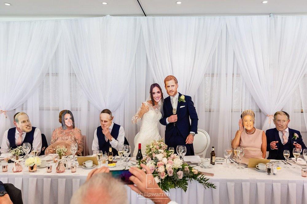 royal wedding masks during wedding reception