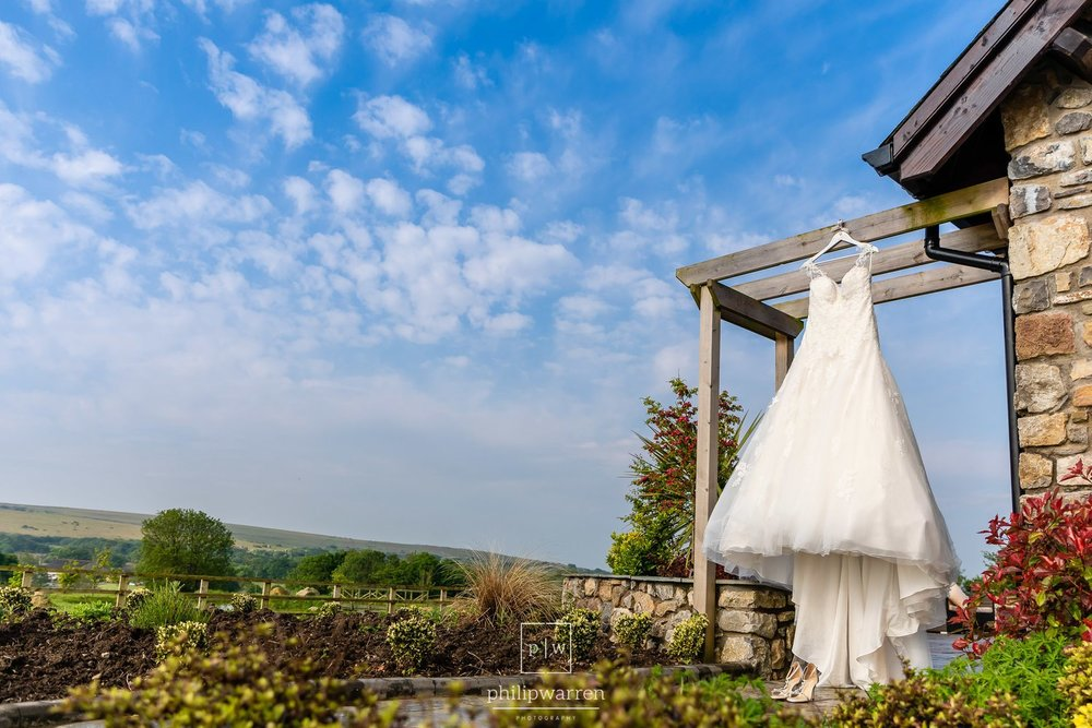wedding dress hanging outside mulberry house gower