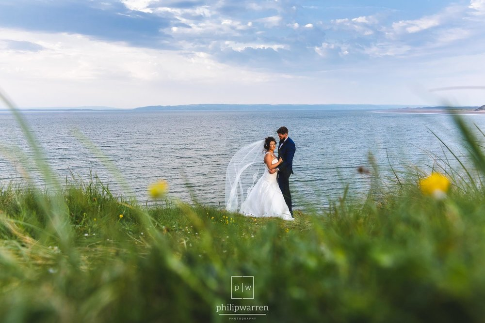 wedding photos of bride and groom on gower beach