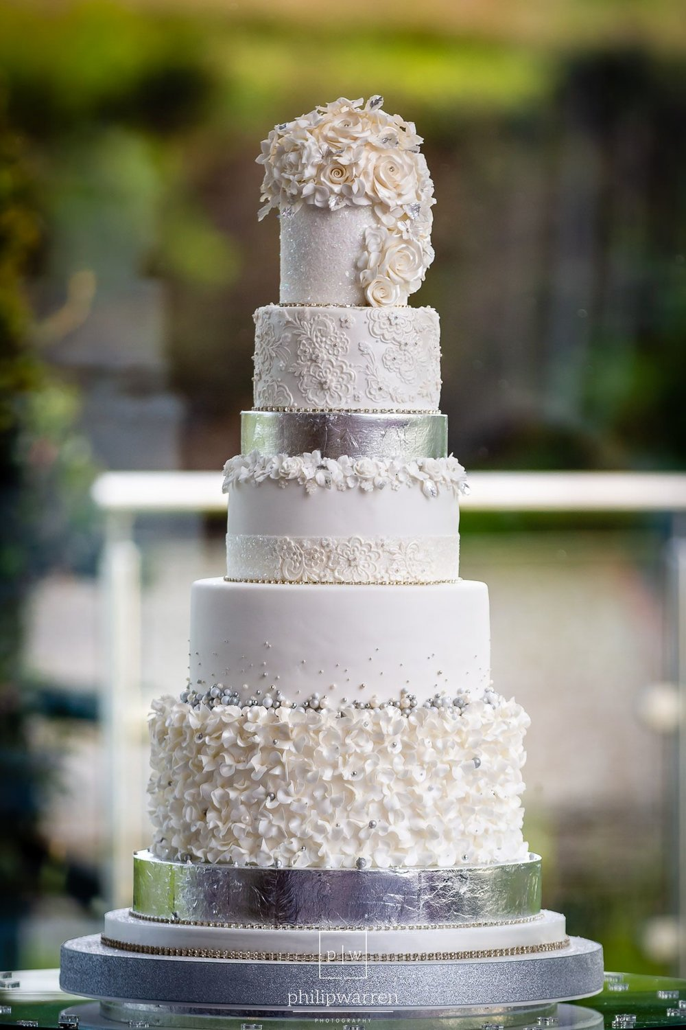 six tier white wedding cake on stand at oldwalls