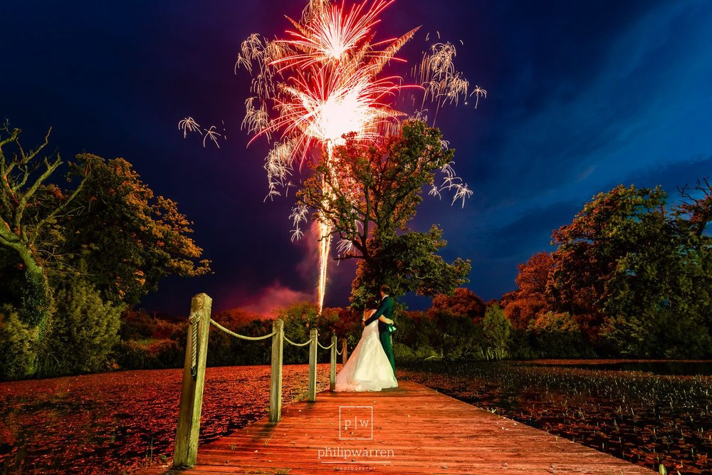 bride and groom watching fireworks at oldwalls gower wedding on