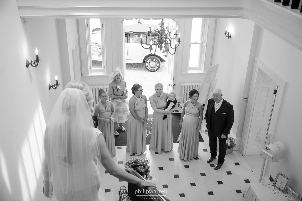 bride walking down the stairs at st tewdrics house