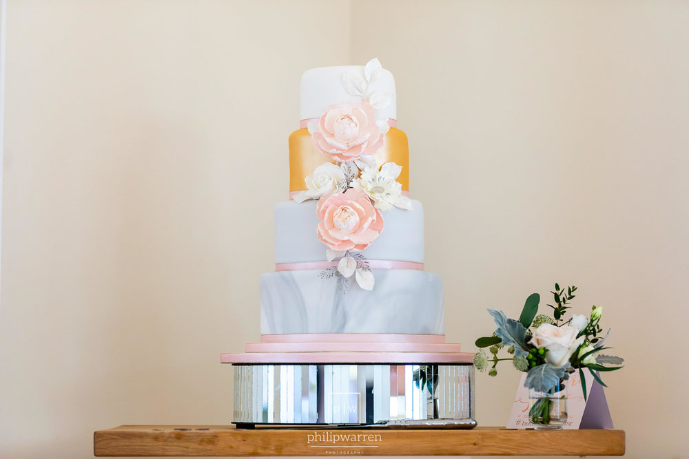 wedding cake with flowers on a stand
