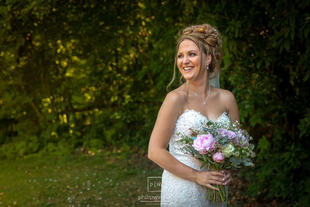portrait of the bride holding her bouquet