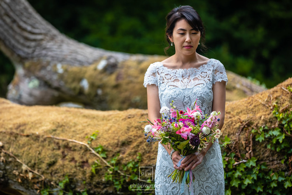 bride holding her bouquet of flowers during outdoor ceremony