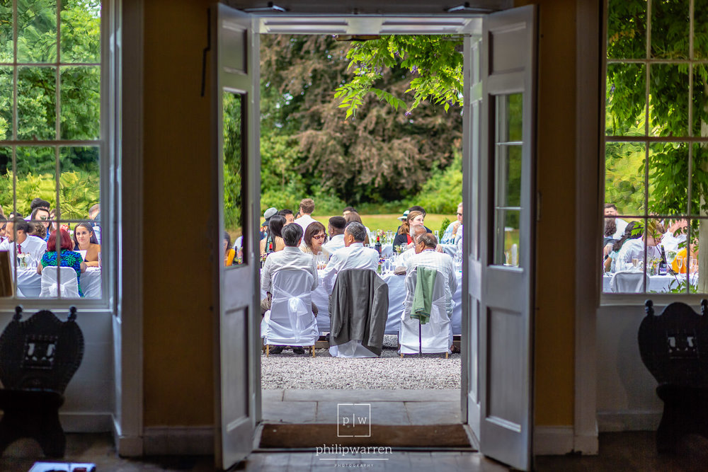 view of the outdoor wedding breakfast from inside plas glansevin