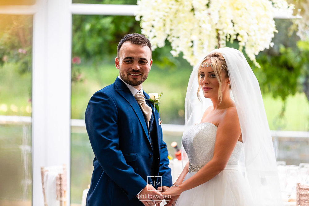 bride and groom portrait in the marquee at oldwalls