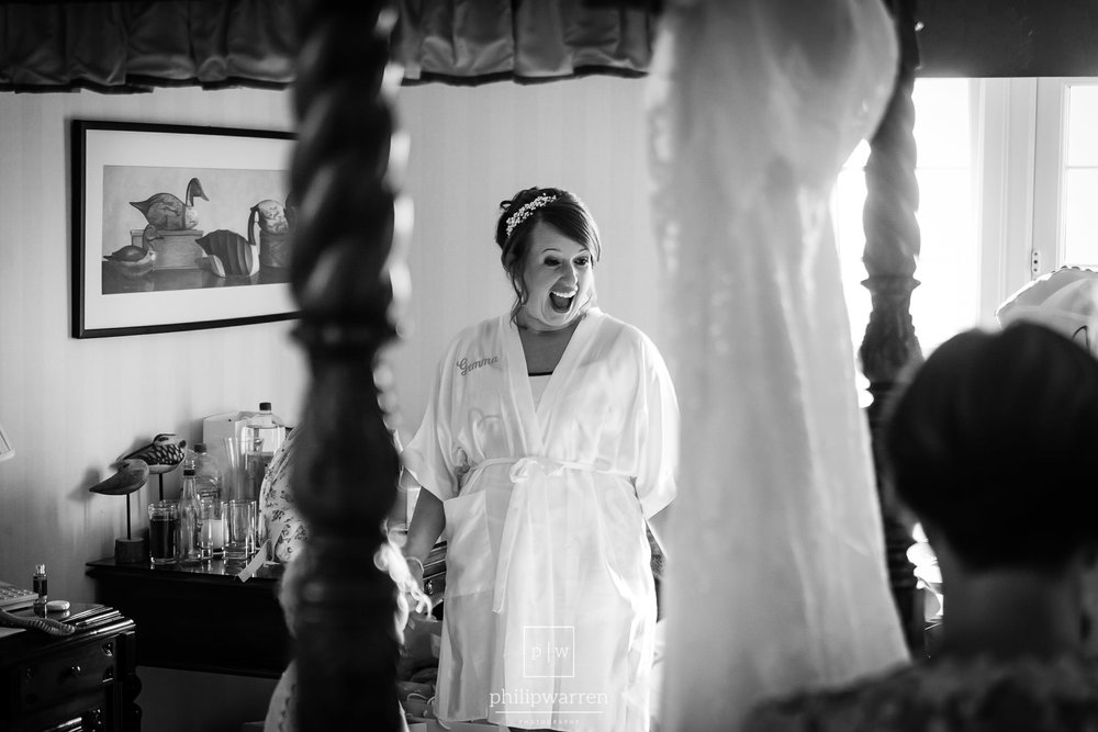 bride standing in amazement during bridal preparations