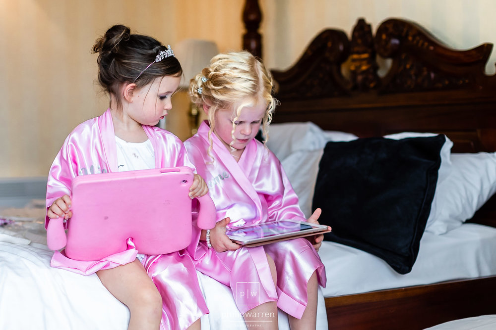 flower girls playing on ipads