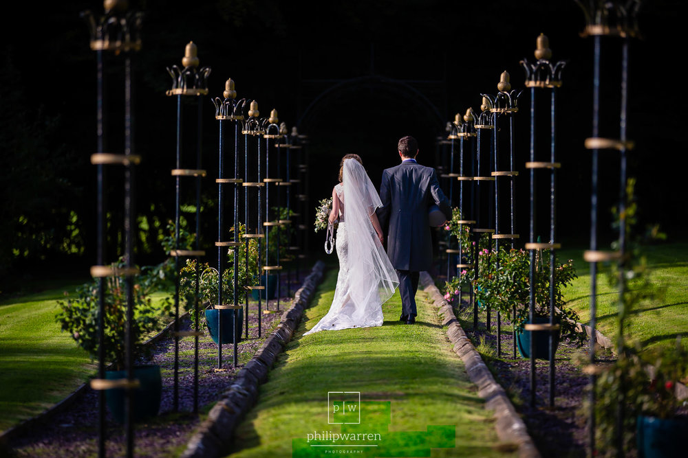 bride and groom in gardens at court colman manor bridgend