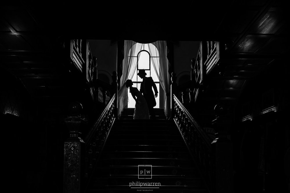 silhouette of bride and groom on the stairs at court colman