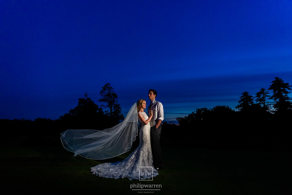 night photo of bride and groom in front of court colman