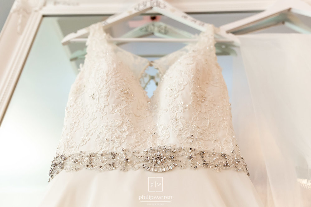 wedding dress hanging on a mirror