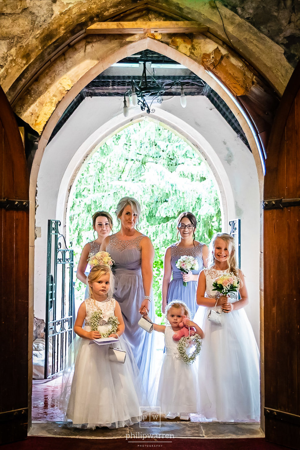 bridal party standing in doorway at the church