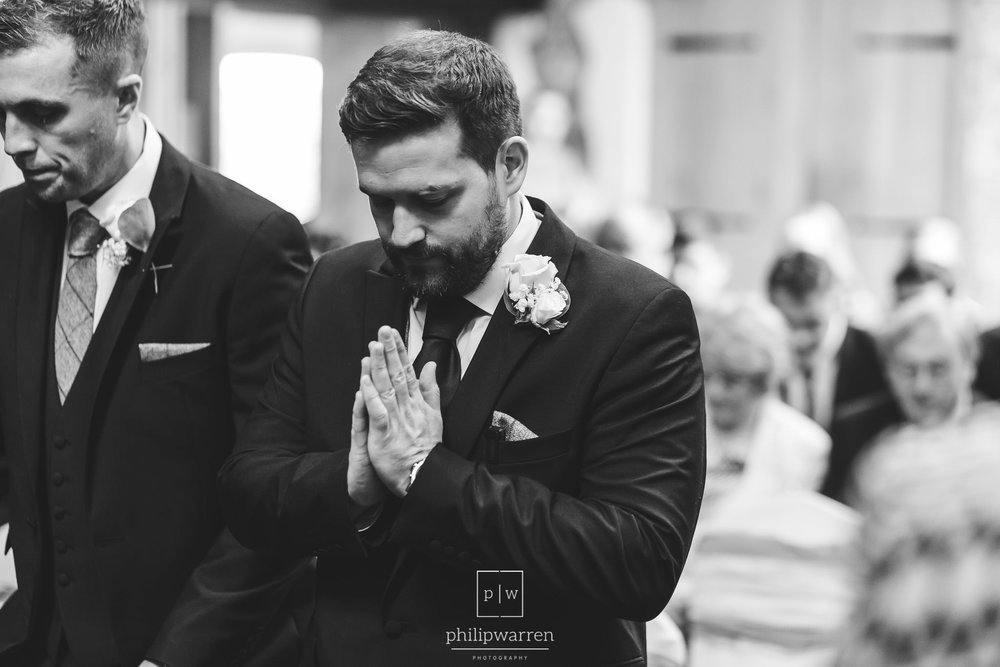 groom praying before the ceremony in oxwich bay hotel