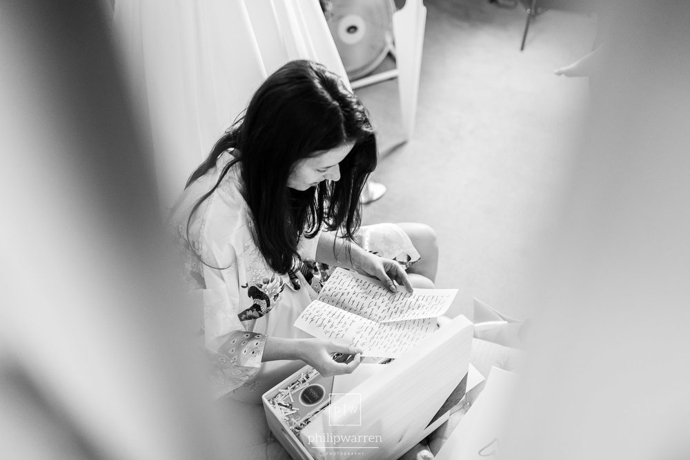 bride reading letter from groom at bryngarw bridal suite