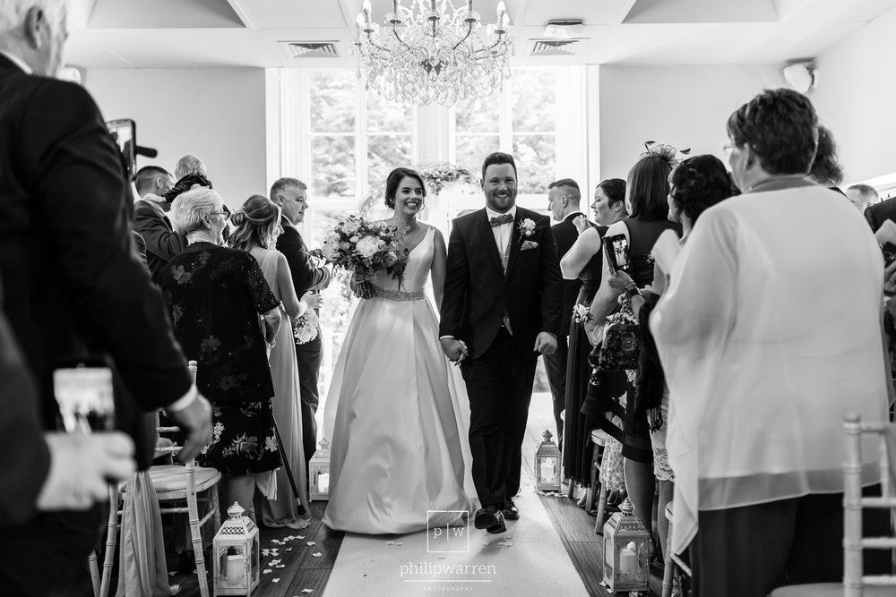 just married and leaving the ceremony room